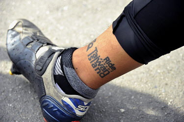 A tattoo on the ankle of an avid Taiwanese cyclist who has circumnavigated the island numerous times.