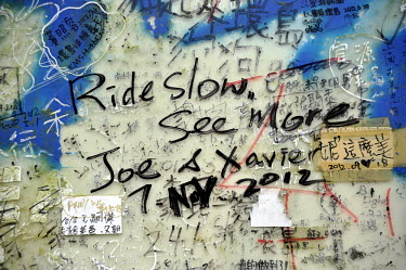 Graffiti written by cyclists on the notice board at the top of a popular hill climb on Route 199, just north of the Kenting National Park area.