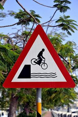 A road sign warning cyclists to beware of riding into the river in the Anping district of Tainan.