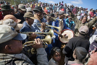 Musicians, among a crowd, playing instruments during Famadihana, a funerary tradition of the Malagasy people. Known as the turning of the bones, people bring out the bodies of their ancestors from the...