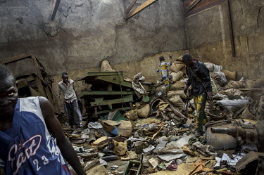 Looters search through a house belonging to a Muslim who fled the city. In 2013 a rebellion by a predominantly Muslim rebel group Seleka, led by Michel Djotodia, toppled the government of President Fr...