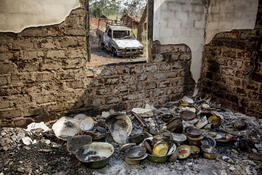 Battered and charred pots and pans in a house that was burned down by Seleka rebels. In 2013 a rebellion by a predominantly Muslim rebel group Seleka, led by Michel Djotodia, toppled the government of...