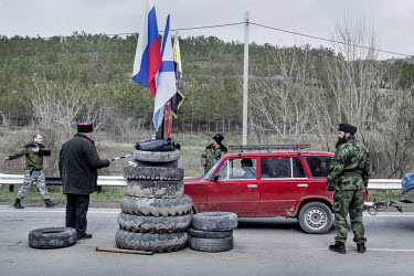 A group of militiamen man a roadblock the town of Verkhn'osadove. The pro Russian militia have set up roadblocks to control movement around Crimea.   Since the end of February, people in parts of east...