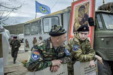 Pro Russian militia wearing Cossack insignia man a roadblock near Verkhn'osadove. They have set up roadblocks to control movement around Crimea.   Since the end of February, people in parts of eastern...