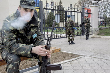 Russian and Ukrainian troops guard a military base at Belbek near Sevastopol. Following the fall of President Yanukovych in Kiev, militia wearing uniforms without insignia quickly moved to take contro...