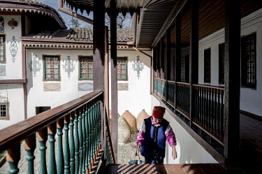 A woman walks up the stairs at the Khan's Palace (or Hansaray), build in 1532, which served as the seat of power of the Crimean Khans until the region was incorporated in the Russian empire.   The Cri...