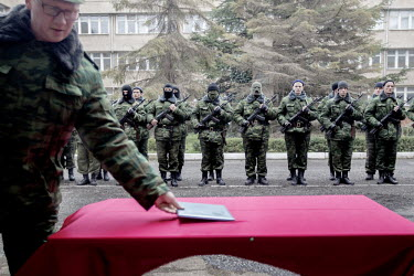 A group of men, some wearing hoods, at a swearing in ceremony after they volunteered for a militia in support of the pro Russian administration of Crimea led by Sergey Aksyonov who was made Prime Mini...
