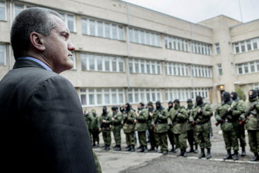 Sergey Aksyonov attends a swearing in ceremony of pro Russian militia who have recently volunteered in support of the pro Russian administration of Crimea. Aksyonov was made Prime Minister of the regi...