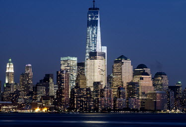 One of the newly built World Trade Center towers in Manhattan illuminated at night.