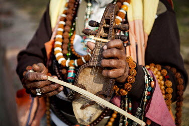 A man is selling a musical instruments inside the Pashupati temple.