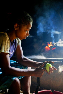 16 year old Sabine, an orphan who looks after her five brothers and sisters, prepares a meal.