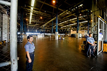 Security guards at the entrance to the cargo holding facilty at  Bangkok's Suvarnabhumi Airport.