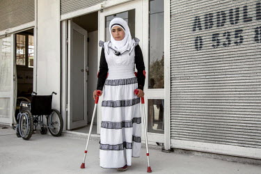 14 year old Nour from Allepo, who lost her right leg in a bomb attack, outside the prostethics clinc where she was treated. The clinic was set up by Syrians to treat their fellow Syrians injured acros...