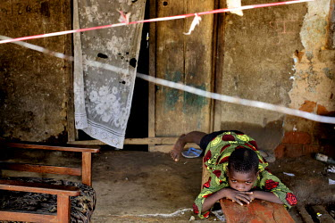 Nine year old Idris Conthe, whose mother recently died from ebola, lies on a bench in his family home which is under quarantine along with 46 households on the main street of Grafton after at least 17...