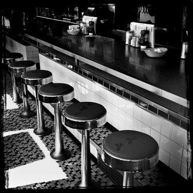 Bar stools in a roadside diner.