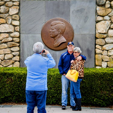 Visitors photograph each other at the John F Kennedy Memorial in New England.