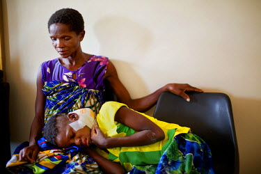 Pilirani Shadi, 12, with her mother Alisaneti at the Queen Elizabeth Central Hospital. Pilirani became ill in 2012 and at first they visited a traditional healer who administered crushed herbs. They t...