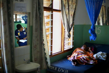 Annie Khyuza Kasaka, 36, a registered midwife/palliative care nurse, makes a ward round at Mulanje Mission Hospital. Pioneering work with palliative care in rural Malawi is increasing the quality of l...