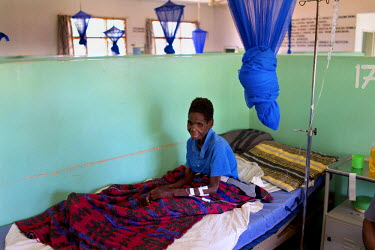 Annie Josaya, 48, sits up in her hospital bed. She has advanced cervival cancer and receives palliative care, including symptomatic relief, at the Mulanje Mission Hospital. Pioneering work with pallia...