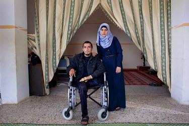 24 year old Abdullah Abu Harbeed, from Biet Hanoun, at home with his wife. He sustained explosive injuries and lost his left leg in the Israeli summer offensive on Gaza. His injuries were so severe th...