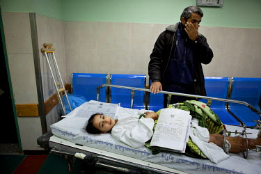 Weam Al Astal, a nine year old from Khan Younes, with her father as she prepares to undergo surgery after she received serious injuries during the summer 2014 Israeli military operation ('Pillar of De...