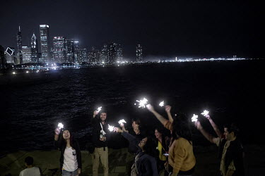 American people gathered on the banks of Lake Michigan to celebrate the 4th of July.