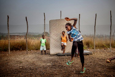 Children play in an orphanage run by Miriam Mason Sesay, a British woman of Sierra Leonean descent. The orphanage has an isolation ward where children need to stay for 21 days when they arrive to moni...