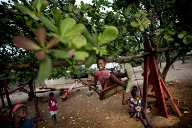 Children play on the swings at an orphanage run by Miriam Mason Sesay, a British woman of Sierra Leonean descent. The orphanage has an isolation ward where children need to stay for 21 days when they...