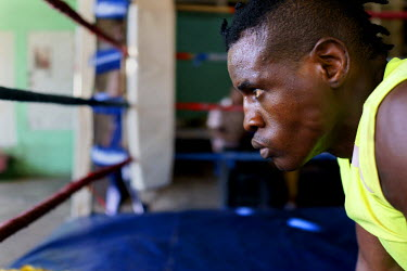 Yomi Shokunbi, a Nigerian living in South Africa, training at George Khosi's Hillbrow Boxing Club. Currently a model and fitness trainer, Yomi hopes to qualify for his boxing license in a few weeks ti...