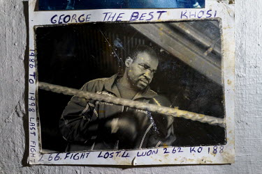 An old photograph of George Khosi, founder of the Hillbrow Boxing Club, annotated with his boxing record.  Hillbrow, in downtown Johannesburg, is the city's most notorious neighbourhood. It is overcro...