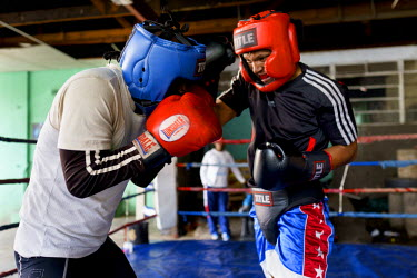 Siyakudumisa Vapi (right), a licensed boxer hoping to make it as a professional, sparring at the Hillbrow Boxing Club. Vapi is training for a fight against the third-ranked fighter in the national fea...