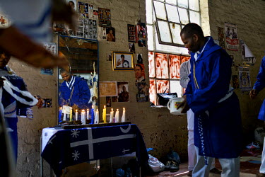 Members of the Zionist Church hold a service in the weight's room of George Khosi's Hillbrow Boxing Club. The church rents the space for a Sunday 'spirited prayer meeting'.  Hillbrow, in downtown Joha...