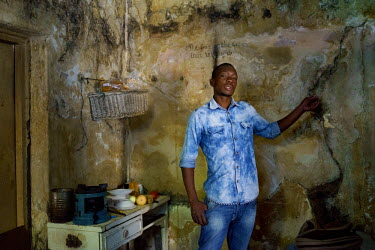 Oskido in his room in a 'hijacked building' (slang that describes an illegally occupied squat) in Hillbrow. The building has neither electricity nor running water, and the walls and surviving windows...