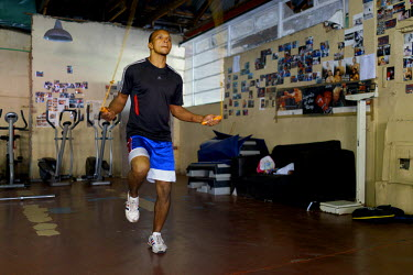 Siyakudumisa Vapi, a licensed boxer hoping to make it as a professional, skipping during training at the Hillbrow Boxing Club. He is training for a fight against the third-ranked fighter in the nation...