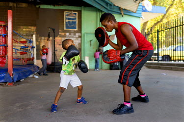 Natalie Baniea trains a young boy during an afternoon session at the George Khosi's Hillbrow Boxing Club. As the club does not have the resources to provide child-size equipment, the youngsters make d...