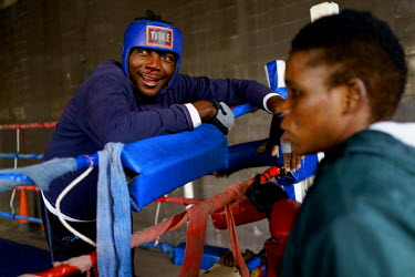 Aspiring professional boxer Phana Khumalo (24) smiles, despite his bloodied nose, after a sparring session at the Hillbrow Boxing Club.  Hillbrow, in downtown Johannesburg, is the city's most notoriou...