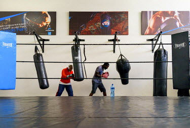 Julie Tshabalala (left), South African Womens welterweight and middleweight champion, training at the Bronx Gym in Johannesburg. She won her first championship while under the tutelage of George Khosi...
