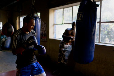Siyakudumisa Vapi, a licensed boxer hoping to make it as a professional, trains at the Hillbrow Boxing Club in Johannesburg. Vapi is training for a fight against the third-ranked fighter in the nation...