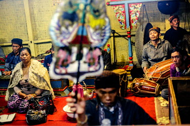 Villagers perform the 'Wayang Golek' a traditional form of theatre using hand manipulated dolls accompanied with singing and the playing traditional musical instruments during the lunar ceremony. Ofte...