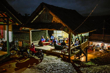 Villagers perform at night, singing and playing traditional bamboo musical instruments known as Angklung, during the lunar ceremony. The performance is a celebration and a way to give thanks for the b...