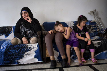 Hasna's pictured with her nieces Aseel and Hadeel, both 4, at their shared home in Tripoli, Lebanon. On the 31 March 2012 at 3:00pm, Hasna, her husband and her children were on a motorcycle in Qusayr...