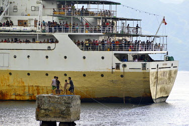 The passengers crowd the deck as the PELNI (Indonesia's national shipping line) vessel 'Awu' arrives in Ende ferry port on one of it's twice monthly visit