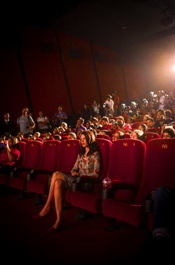 Indian born French actress Kalki Koechlin (2nd from right) sits on the front row to watch the launch of the trailer of her her latest film, Margarita with a Straw (Choone Chali Aasman) in a cinema in...