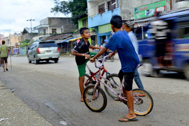 Young boys gather after school on their bicycles to ride up and down the main street of Waikabubak, the provincial capital of West Sumba.
