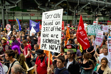 A placard reads 'Tory cuts based on 37 percent of the vote are sickening. PR NOW!' held aloft during the March Against Austerity in central London 20 June 2015.