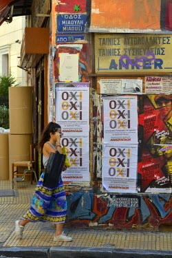 A women in the central Monastiraki district of Athens walks past posters campaigning for a 'No' ('Oxi') vote in the bailout referendum. In the leadup to the end of Greece's bailout programme from the...