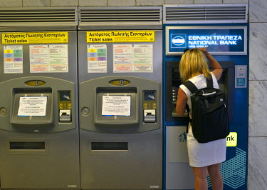 A woman tries - unsuccessfully - to withdraw her daily 60 Euros limit from an ATM machine in the main Syntagma Metro sttaion. In the leadup to the end of Greece's bailout programme from the 'troika' (...