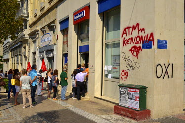 Members of the public queueing outside a bank in the central Athens Syntagma district to try and withdraw their money (limited to 60 Euros a day each) from ATM machines. In the leadup to the end of Gr...