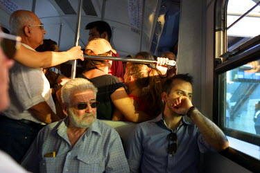 Commuters on a train travelling from Piraeus to Athens on the day before a national referendum to acceptance or reject economic reforms demanded by the country's creditors. The outcome could determine...
