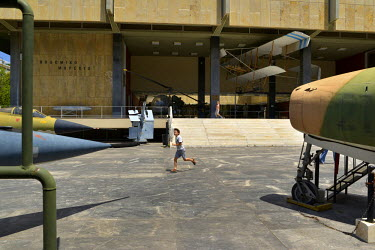 A child plays among the jets on display at The War Museum on the day before a national referendum to acceptance or reject economic reforms demanded by the country's creditors. The outcome could determ...